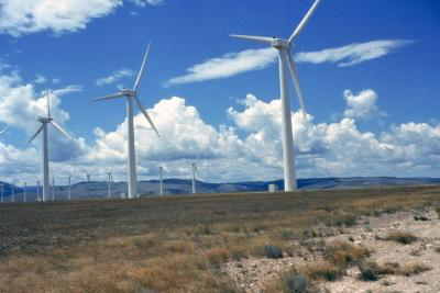 Solar and wind power pose a challenge for the U.S. electrical grid, which lacks the capacity to store surplus clean electricity and deliver it on demand. Researchers are developing grid-scale storage batteries, but the fossil fuel required to build these technologies could negate some of the environmental benefits of new solar and wind farms, say Stanford scientists. Credit: Eugene Water & Electric Board/NREL