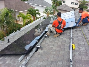SolarEdge power optimizers are installed by Eco Solar on a rooftop in Hawaii. Module-level power electronics, like power optimizers, are growing in popularity.
