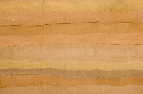 The striations, natural earthtone colors, and textures of a rammed earth wall, the latest ecological building material. Source: Shutterstock