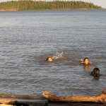 Children swim in Lake Athabasca on July 2 in Fort Chipewyan, Alberta. Photo Credit: Dot Griffith
