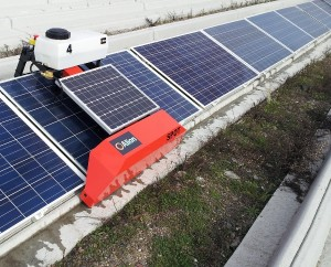 """The Alion Energy cleaning robot """"Spot"""" connects to the concrete foundation's mounting rail to clean each module man-free."""