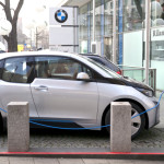 A BMW i3 electric car gets a charge. The vehicle is a hot new model expected to sell well, but the EV market can only reach its potential with expanded charging and consumer awareness, along with the easing of range anxiety. Photo credit: Kārlis Dambrāns/Flickr Creative Commons
