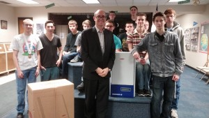 Pictured is Director of Solar Energy Thomas Enzendorfer with the donated inverters and students.
