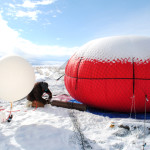 National Oceanic and Atmospheric Administration researcher Bryan Johnson (left) and University of Colorado Boulder researcher Detlev Helmig set up a tethered balloon to collect air samples above Utah's Uintah Basin. Photo credit: Chelsea Thompson, via Chemical & Engineering News