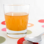 A glass of raw, unfiltered apple cider vinegar, with