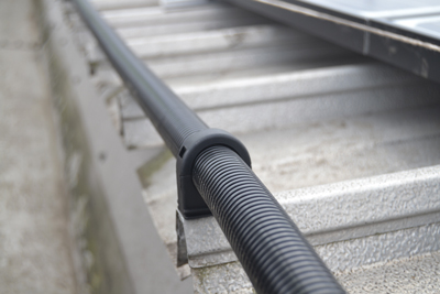 Flexicon's FPAS nylon corrugated conduit, connected using an FPA T-piece to tap off to each solar array.